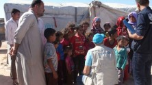 UNICEF speaks with displaced mothers and children living in make-shift tents and shelters in the neighborhood of Majabel, western Aleppo city, Syria.