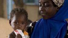 Zahira, 2, eats from a packet of RUTF, a high protein, vitamin-rich, peanut paste for malnourished children