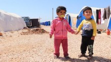 Displaced by escalating violence in Syria's Afrin district since January 2018, approximately 4,000 families — including these children — have settled in the Fafin makeshift camp.