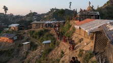 Rohingya children walk along a steep slope at the Unchiprang refugee settlement in Cox's Bazar, Bangladesh in January 2018.