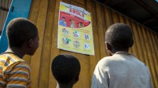 Children read an Ebola-awareness poster in North Kivu, the Democratic Republic of the Congo (DRC) in August 2018.