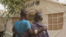 Two injured children stand outside a UNICEF tent at the regional hospital in Mopti, Mali after their village, Ogossagou-Peulh in Bankass, in Mali's Mopti region, was attacked on the night of March 23, 2019.