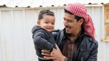 Syrian refugee Shaheen holds his 1-year-old son Mohammad in Jordan's Azraq refugee camp. Mohammad was born in the camp's UNICEF-supported pediatric ward.