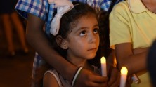 At Dag Hammarskjold Plaza in New York City in September 2016, a young girl from Syria attends a candlelight vigil in support of child refugees uprooted from their homes around the world by conflict, violence, poverty, extreme weather and drought.
