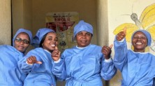 UNICEF-supported health workers celebrate the end of the Ebola outbreak in eastern Democratic Republic of the Congo in June 2020.