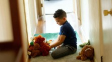 Luka, 8, plays with toys after completing his school work at home in Connecticut.