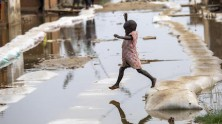 On March 4, 2021, a child plays in the floodwaters in Gatumba, located near Bujumbura in Burundi.