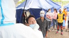 On May 5, 2021, individuals and families making the crossing from India into Nepal at the Birgunj point of entry in Parsa District in southern Nepal are met by border personnel and UNICEF-supported health workers for COVID antigen tests.