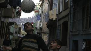 Boys play football on the streets of Tarlabasi, a relatively poor section of the city of Istanbul.