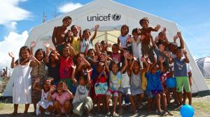 children play outside a tent serving as a UNICEF child-friendly space in the town of Tanauan – one of the areas hardest hit by the disaster – in Leyte Province, Eastern Visayas Region