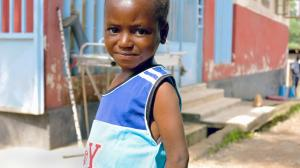 Vandy Jawad, 7, stands in the city of Kenema, Eastern Province, Sierra Leone. He is a survivor of Ebola virus disease .
