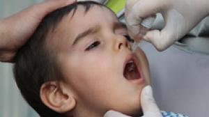 On 20 February 2014 in Turkey, a boy receives a dose of oral polio vaccine, in Osmaniye Province