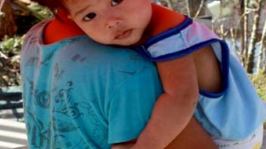 A baby look at the camera after the typhoon