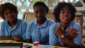 Girls in the West Point neighborhood of Monrovia, Liberia particpate in a workshop to help customize UNICEF's U-Report technology to reach the country's young people most effectively. UNICEF deployed U-Report in Liberia to help raise awareness of Ebola.