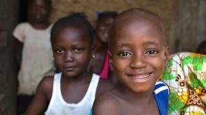 Sierra Leone, a young Ebola survivor and his sister near Freetown, the capital