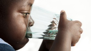 After UNICEF dug a new well in his Malawi village, Tamadani, 2, drinks a clean glass of water