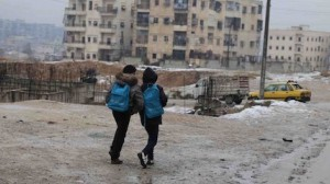 Two boys head home after school in East Aleppo in a snow day for the city. Following almost five years of the Syria crisis, 4.5 million people continue to live in areas – like this one-that are hard to reach for the humanitarian community.