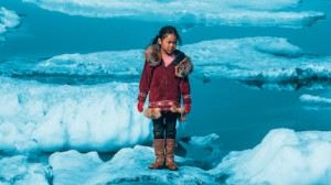 An Iñupiat girl Amaia, 11, standing on a ice floe on a shore of the Arctic Ocean in Barrow, Alaska in the United States of America. The anomalous melting of the Arctic ice is one of the many effects of global warming.