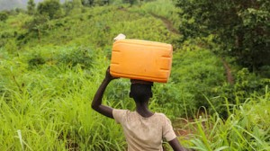 Liliane, 14, carries an empty container as she makes her way to collect safe drinking water in Mukerezi-Mpakaniro hill, Makamba Province, Burundi, Wednesday 25 January 2017.