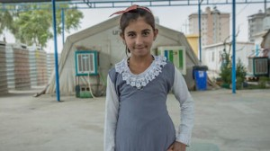 Originally from Bashiqa, Iraq, Sakina, 12, lives with her family at the Harsham camp outside Erbil, Iraq.