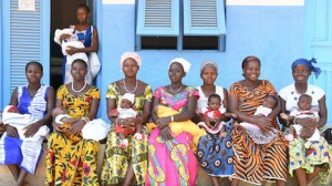 Mothers and newborns wait outside the UNCIEF-supported maternity health center in the village of Nassian in northwest Côte d'Ivoire in 2017.