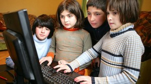 Children use a computer at a UNICEF-supported, small-group home in the southeastern city of Rustavi, Georgia.