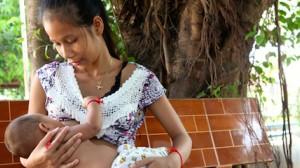 A mother in Cambodia breastfeeds her baby.