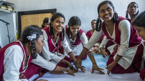 Girls participate in a UNICEF-supported menstrual health and hygiene program in India.