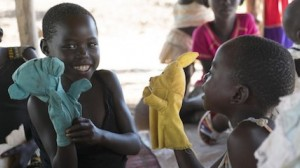South Sudanese refugee children practice their storytelling skills with locally made hand puppets at the UNICEF-supported Bright Early Childhood Center in Uganda's Yumbe district.
