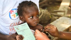 girl receives meningitis vaccine from UNICEF-supported health team in Côte d'Ivoire