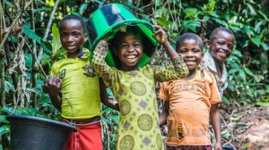 Children clown around while collecting water at a pumping and water distribution station built by UNICEF near Kananga in the Democratic Republic of Congo.