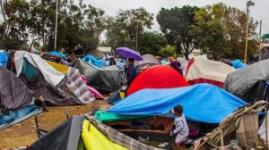 Families migrating from Central America to the U.S. set up makeshift camps in Tijuana, Mexico, one of the most violent cities in the world.