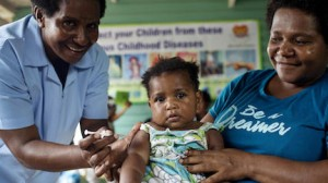 A UNICEF-supported health worker vaccinates a child against measles, mumps and rubella (MMR) at the 9 Mile Health Clinic in Port Moresby, Papua New Guinea in March 2019.