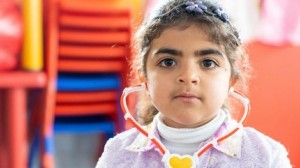 Haneen, 5, in her new kindergarten classroom, built and equipped by UNICEF, in Jordan's Za'atari Refugee Camp.