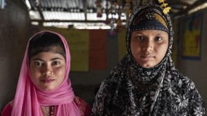 Yasmin (left), 12, a Bangladeshi national, and Showkat, 15, a Rohingya refugee, both attend a UNICEF-supported adolescent club in Lambasia refugee camp, Cox's Bazar, Bangladesh on June 24, 2019.