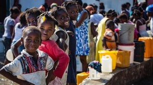 Kids in Haiti collect safe water at a UNICEF distribution point following Hurricane Matthew, which disrupted supplies and put families at risk of cholera and other water-borne diseases.
