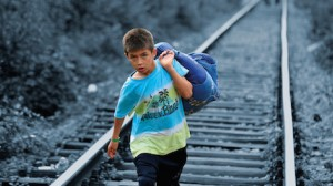 A Syrian refugee crossing into Serbia.