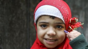 Aneesa, 5, shows the purple ink mark on her little finger that signifies she has received her polio vaccine from a UNICEF-supported vaccinator in the Bhatti gate area of Lahore Punjab Province, Pakistan.