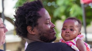 Author, former child soldier and UNICEF Advocate for Children Affected by War Ishmael Beah holds a baby girl during a visit to Ola During Children's Hospital in Freetown, Sierra Leone on November 17, 2019.