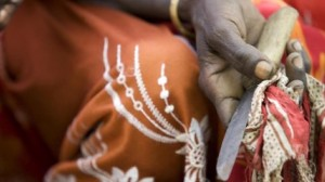In Ethiopia's Afar Region, a former practitioner of female genital mutilation holds the tool she once used to perform the cruel procedure.