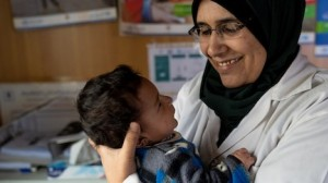 UNICEF community health worker Zain Al Khaldi cares for children and mothers at the Za'atari Refugee Camp in Jordan.
