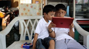 Brothers photographed at home in Cebu, Philippines, where UNICEF works with partners to stem online sexual exploitation.
