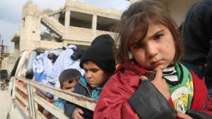 Children ride in the back of a truck fleeing Idlib in northwest Syria due to escalating violence.