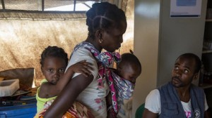Eliza Arnaldo, 20, carried her feverish children, Natalia, 3, and Dominqo, 6 months, from the Ndjenaja resettlement camp to a UNICEF health center on March 4, 2020.