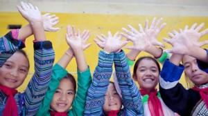 Students from the UNICEF-supported Muong Khuong Boarding School in Lao Cai, Vietnam proudly show their clean hands after they've washed them with soap and clean water.