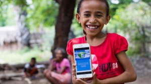 On April 14, 2020, a girl shows off the Learning Passport online platform on which children and parents in Timor-Leste can access a range of audiovisual materials to help students continue learning during ongoing school closures.