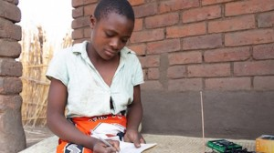 Adawona, age 12, is continuing her education via UNICEF-supported radio lessons in Malawi.