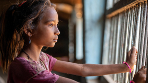 A young girl in Gujarat, India who has lost both parents receives alternative care and mental health and psychosocial support through UNICEF coordinators.
