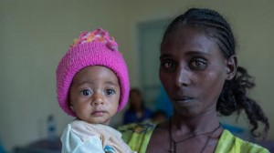 Yeshialem Gebreegziabher, 27, holds her daughter, 6-month-old Kalkidan Yeman, who is suffering from malnutrition, at Aby Adi Health Center in the Tigray region of northern Ethiopia, on June 7, 2021.