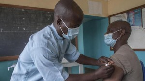 Senior Disease Control Surveillance Assistant Andrew Mbingwani gives Gibson Chikhasu Zulu, a teacher at Chikande Community Day Secondary School, his second dose of COVID-19 vaccine at Chikande Health Center in Malawi's Ntcheu District on June 17, 2021.